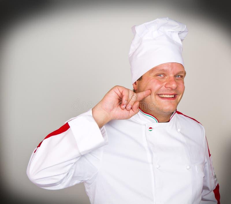 Een Glimlachende chef-kok royalty-vrije stock afbeeldingen