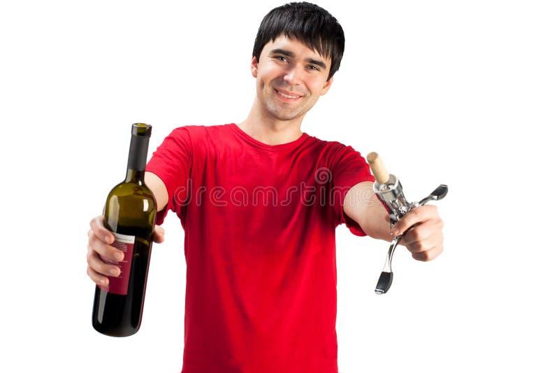Een glimlachende mens met fles wijn royalty-vrije stock afbeeldingen