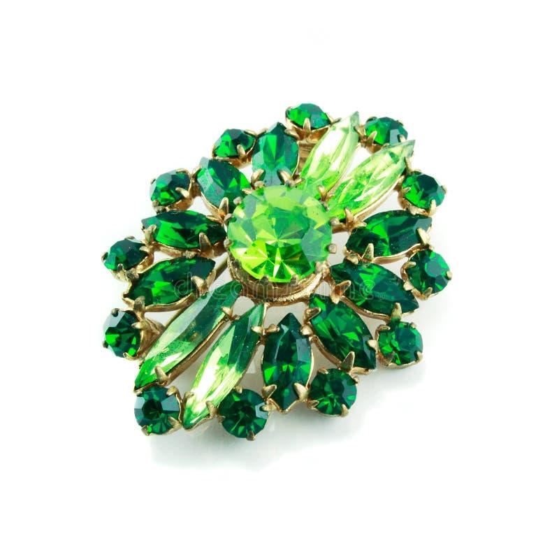 Een groene geïsoleerdei broche royalty-vrije stock afbeeldingen