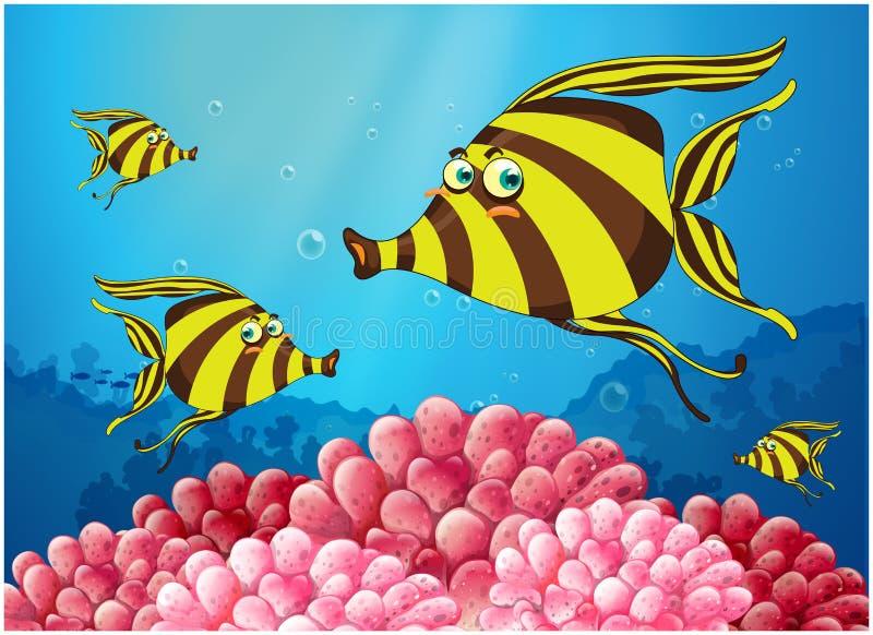 Een groep streep-gekleurde vissen onder het overzees stock illustratie