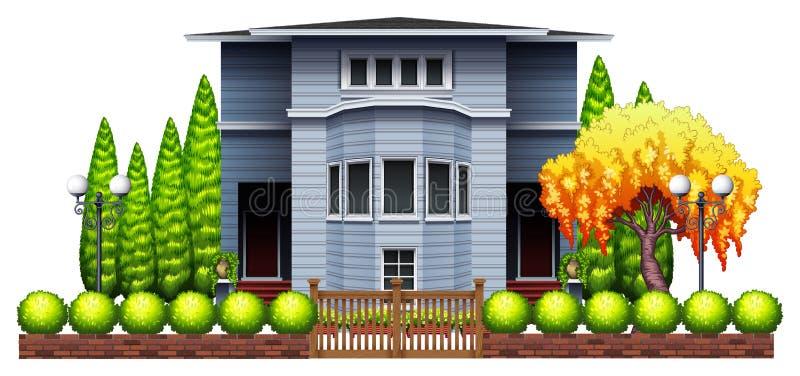 Een groot huis met omheining en installaties stock illustratie