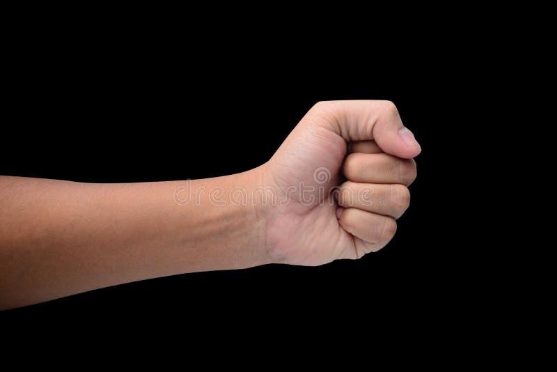 Een hand clutched in zijn vuist op zwarte stock afbeelding
