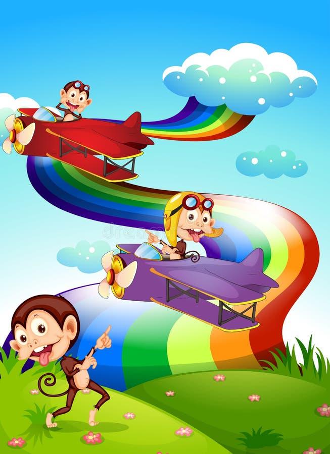 Een hemel met een regenboog en vliegtuigen met apen royalty-vrije illustratie