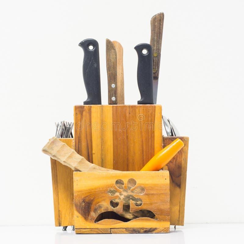 Een houten doos voor opslag knifes lepelt en vork stock fotografie