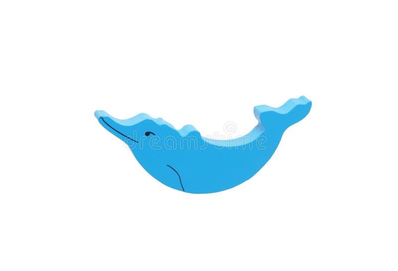 Een houten stuk speelgoed dolfijn stock afbeeldingen