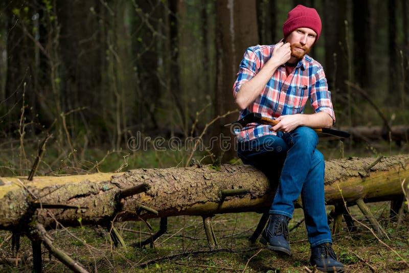 Een houthakker in hout het rusten royalty-vrije stock foto