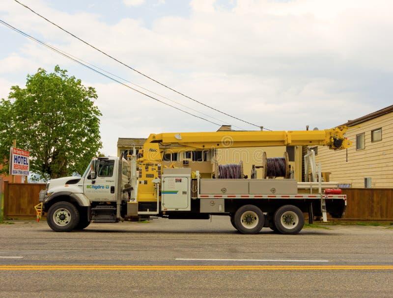 Een hydrovrachtwagen met een hijstoestel bij de harrison hete lentes in Canada royalty-vrije stock foto