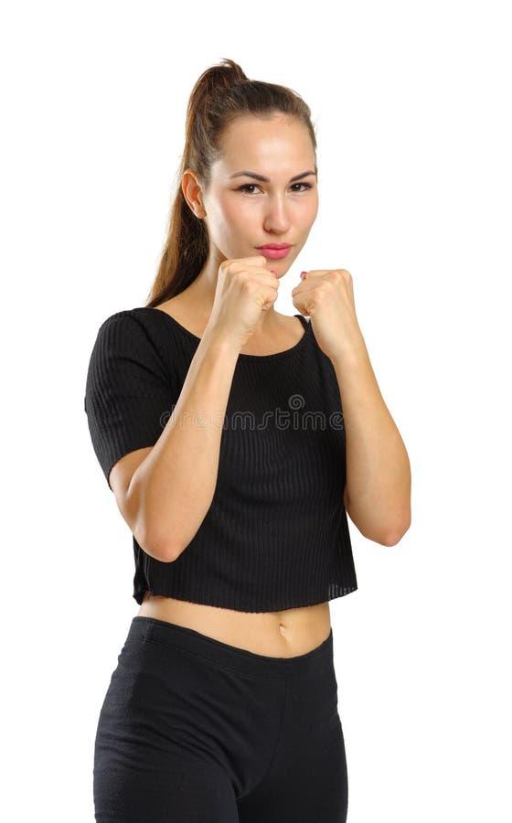 Een jong boksermeisje die een zwart kostuum dragen Geïsoleerdj op witte achtergrond royalty-vrije stock afbeeldingen