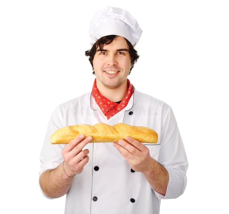 De jonge bakker houdt een brood stock afbeeldingen