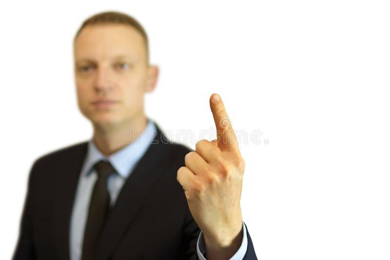 Een jonge en knappe zakenman die met zijn vinger benadrukken stock afbeeldingen