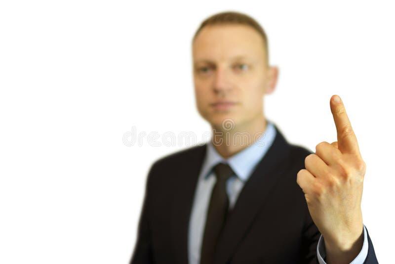 Een jonge en knappe zakenman die met zijn vinger benadrukken royalty-vrije stock foto