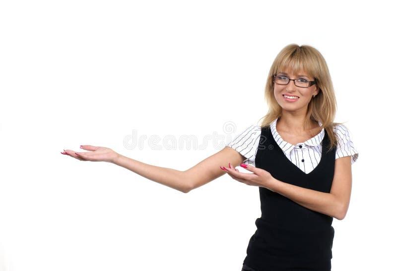 Een jonge leraar toont iets stock fotografie