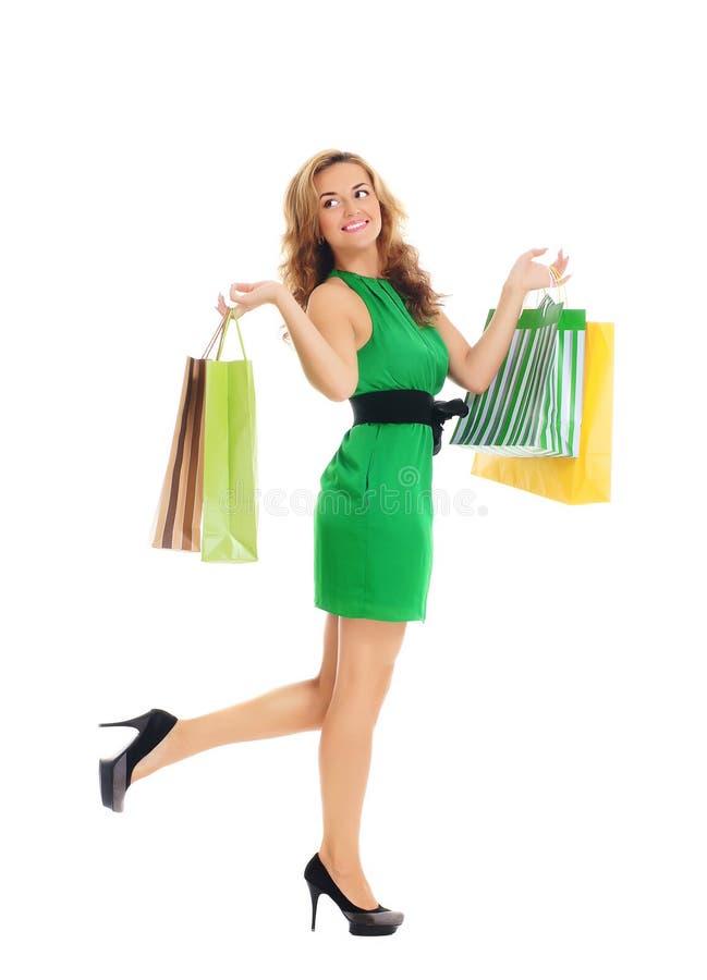 Een jonge vrouw met het winkelen zakken royalty-vrije stock afbeeldingen