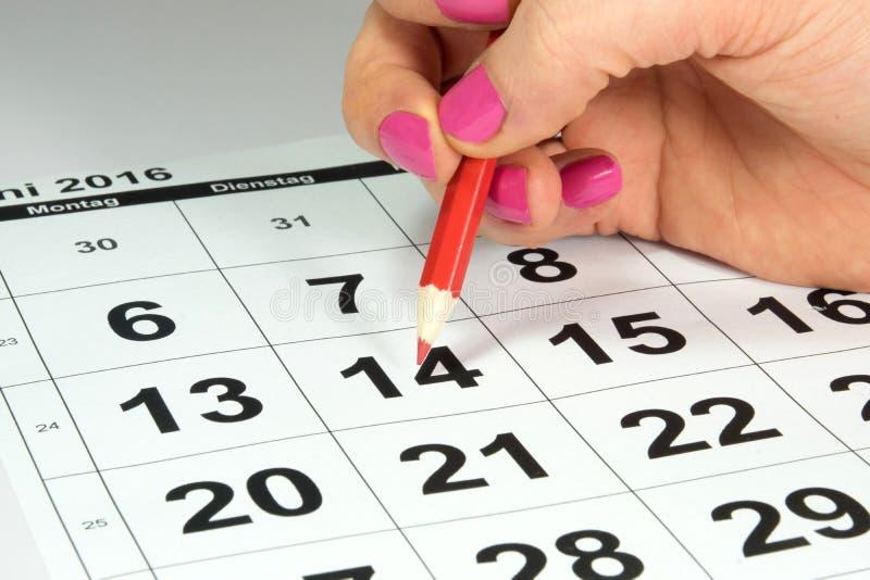Een kalender en een benoeming stock afbeeldingen