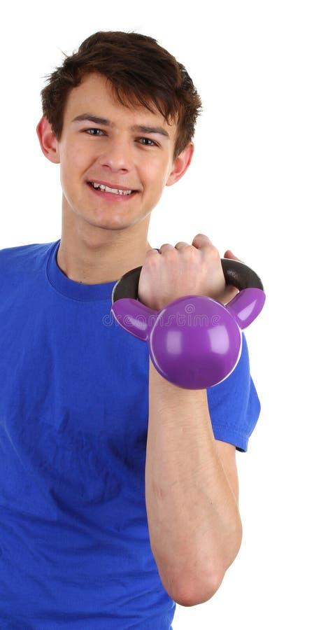 Een kerel met een gewicht stock foto