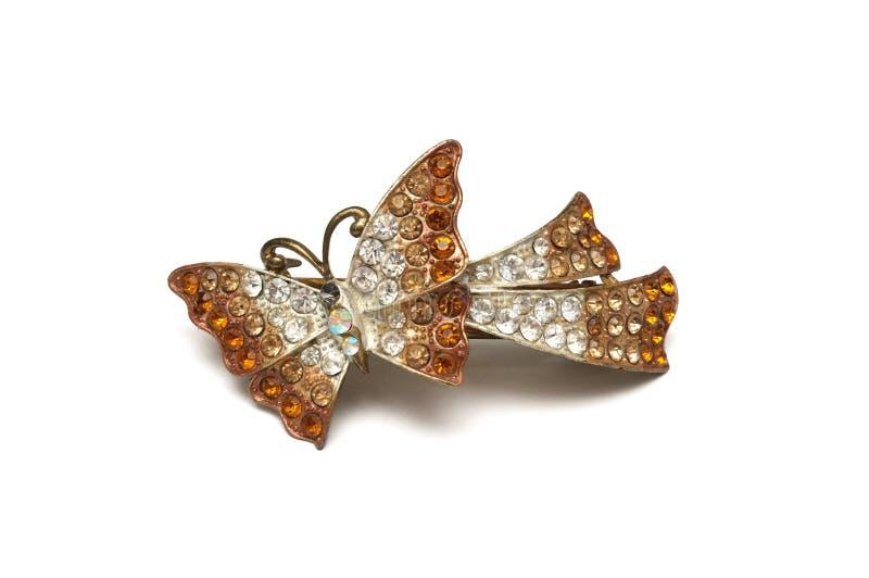 Een klem van het vlinderhaar tegen een witte achtergrond stock afbeelding