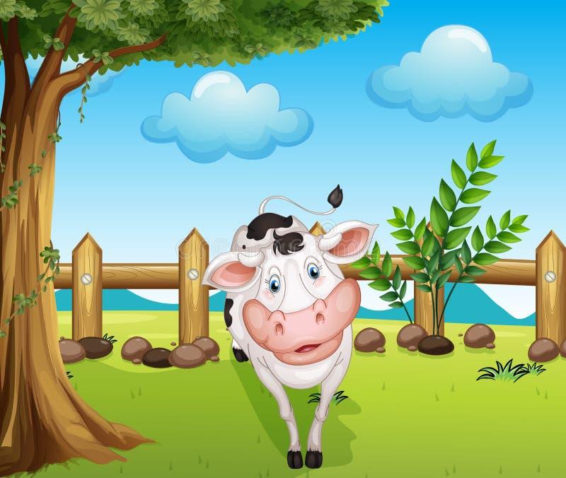 Een koe binnen de omheining royalty-vrije illustratie