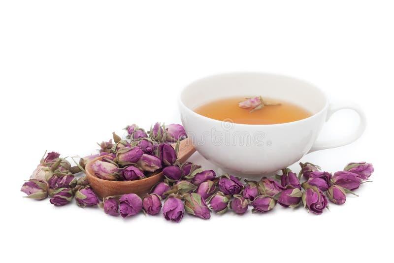 Een kop van roze thee op witte achtergrond stock foto's