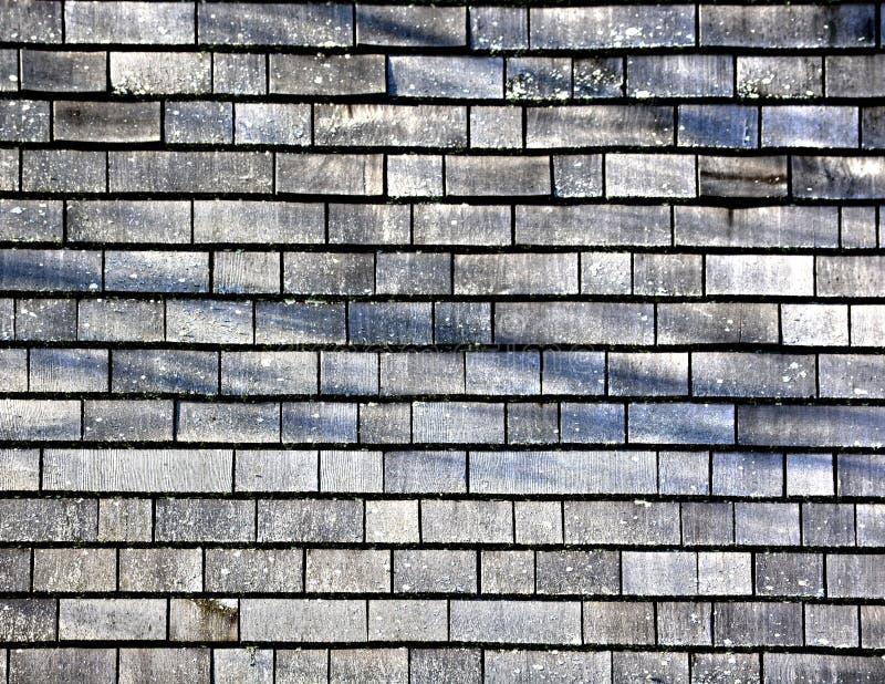 Een langzaam verdwenen houten dakspaanachtergrond stock foto
