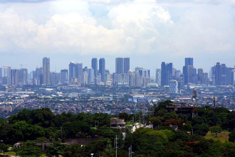 Een luchtmening van commerciële en woningbouw en ondernemingen in de steden van Cainta, Taytay, Pasig, Makati en Taguig royalty-vrije stock foto's