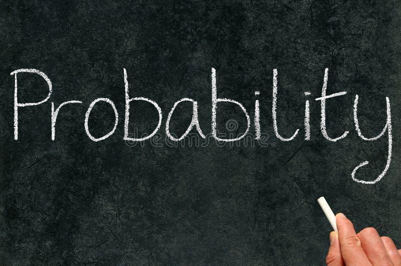 Een mathleraar het schrijven waarschijnlijkheid. stock afbeeldingen