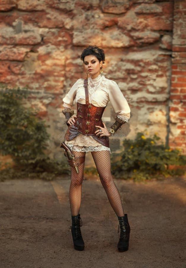 Een meisje in de stijl van steampunk stock foto