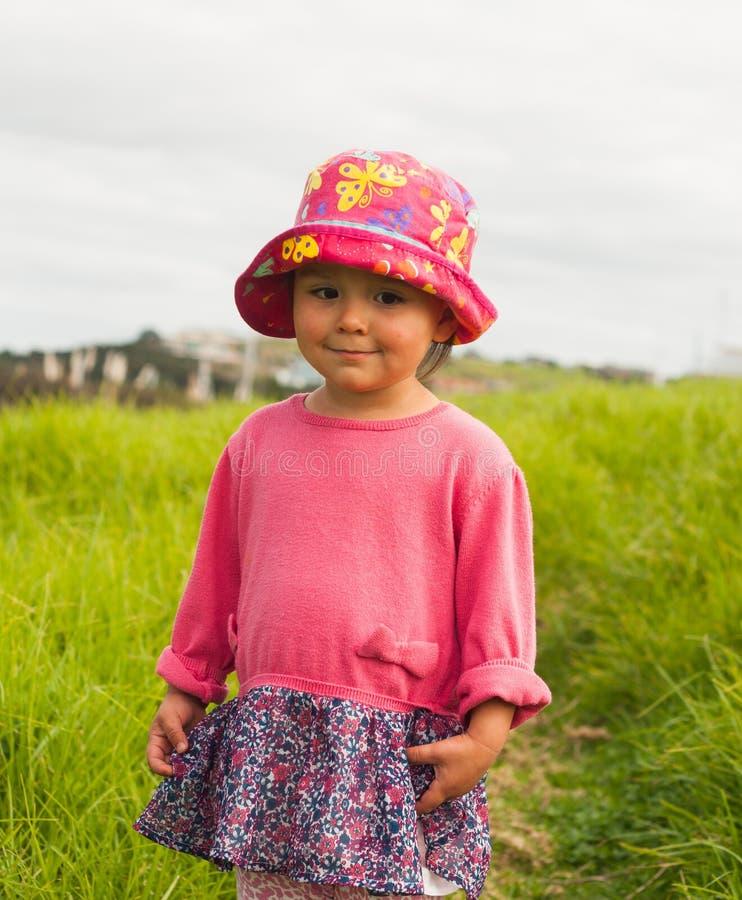 Een meisje in een hoed stock afbeelding