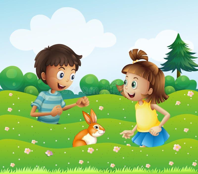 Een meisje en een jongen met een konijntje bij de heuvel vector illustratie