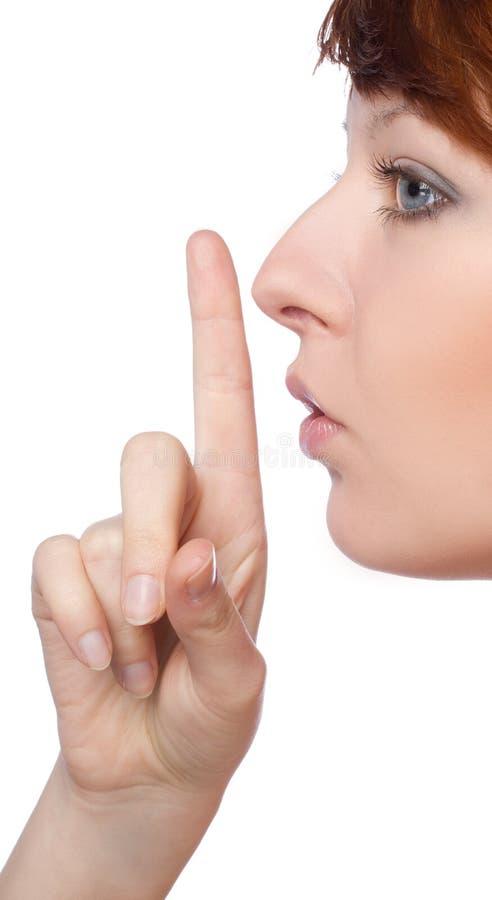 Een meisje houdt een vinger stil aan lippengebaar royalty-vrije stock afbeeldingen