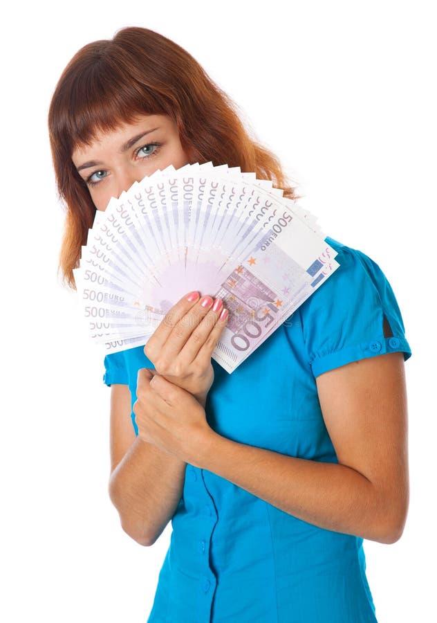 Een meisje houdt geld in haar handen royalty-vrije stock foto