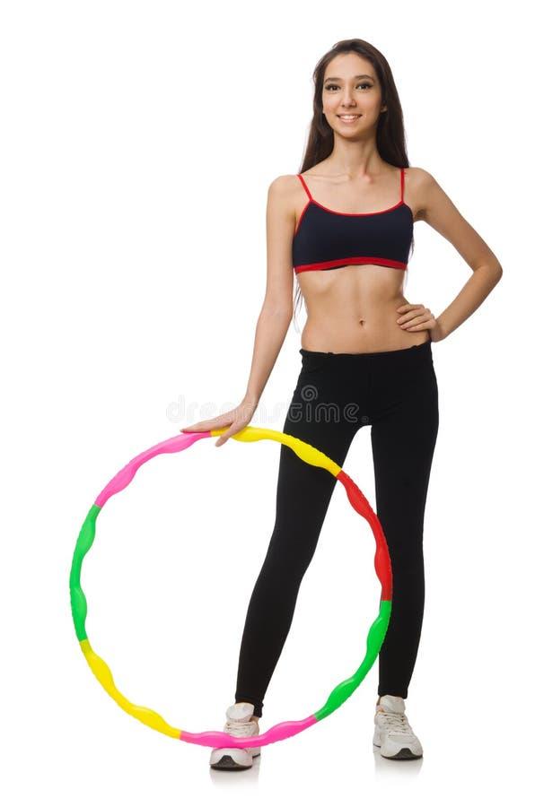 Een meisje in sportkostuum met geïsoleerd hulahoepel stock fotografie