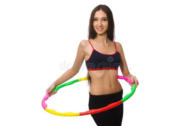 Een meisje in sportkostuum met geïsoleerd hulahoepel stock foto