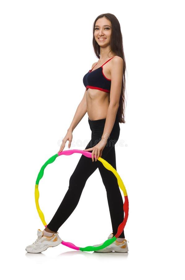 Een meisje in sportkostuum met geïsoleerd hulahoepel royalty-vrije stock fotografie