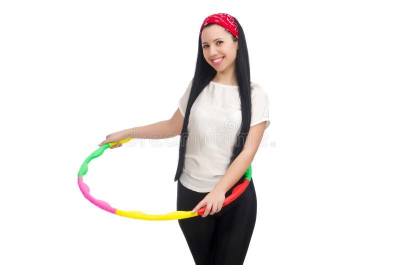 Een meisje in sportkostuum met hulahoepel stock afbeeldingen