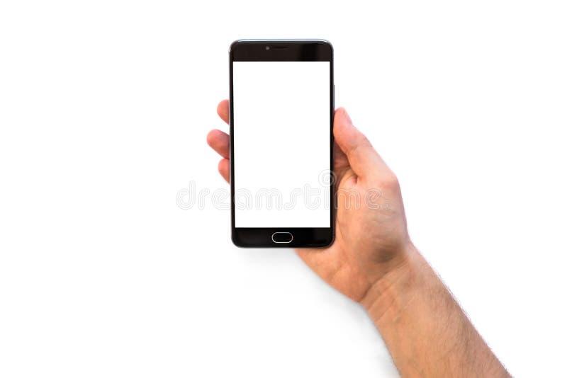 Een mens die een smartphone met het witte lege scherm houden aan montering uw die toepassing op witte achtergrond wordt geïsoleer royalty-vrije stock foto's