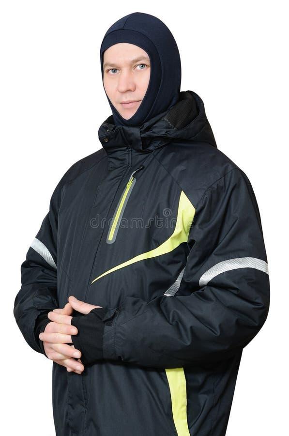Een mens in een jasje van de sportenski stock foto's