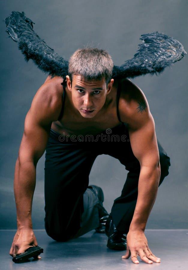 Een mens met engelenvleugels. royalty-vrije stock afbeelding