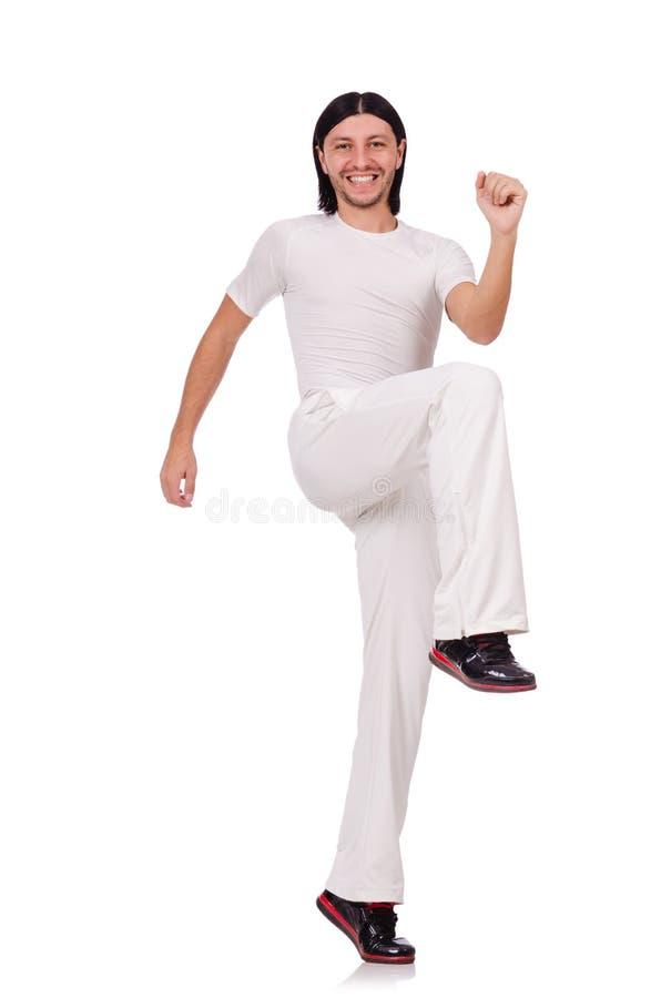 Een mens in witte die sportkleding op het wit wordt geïsoleerd royalty-vrije stock afbeeldingen