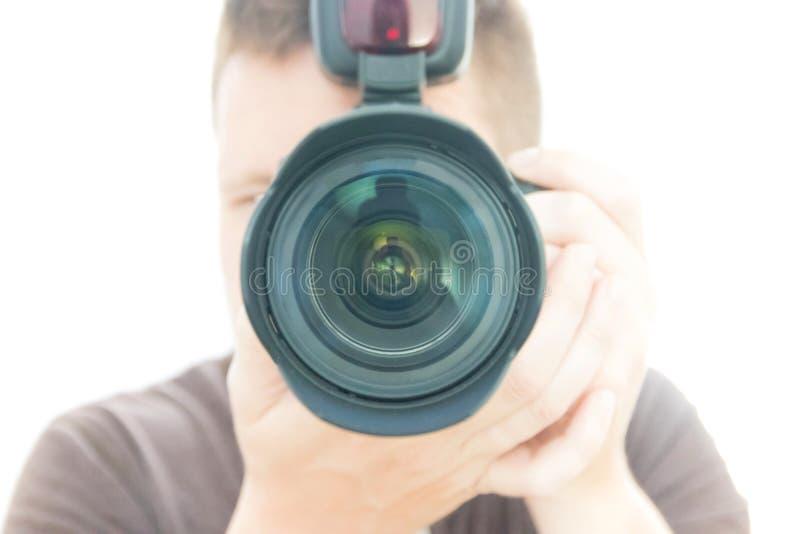 Een mensenfotograaf With camera het Schieten royalty-vrije stock foto's