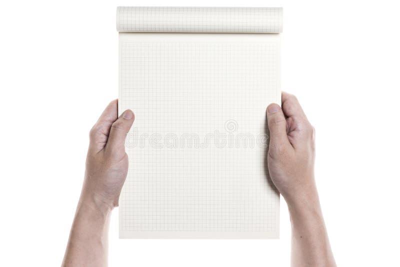 Een mensenhand houdt een nota stock afbeeldingen
