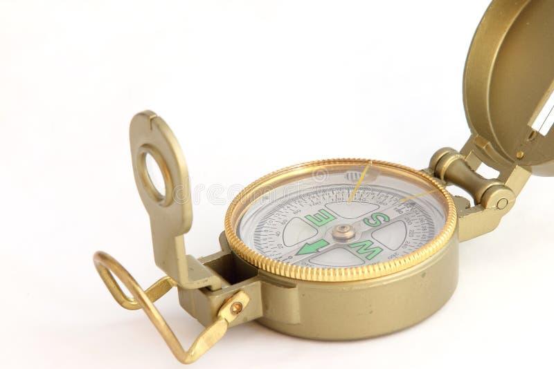 Een metaal, geel kompas stock foto's