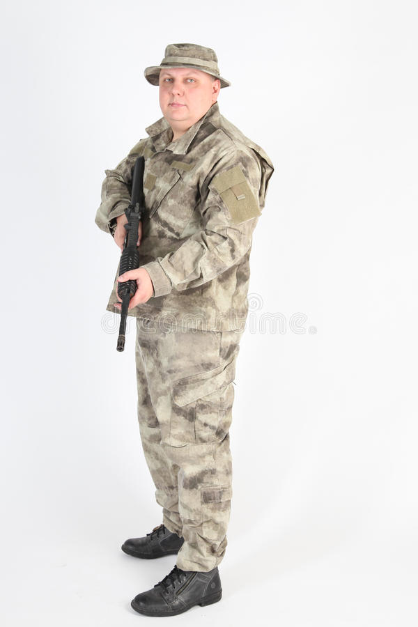 Een militair met kanon stock afbeelding