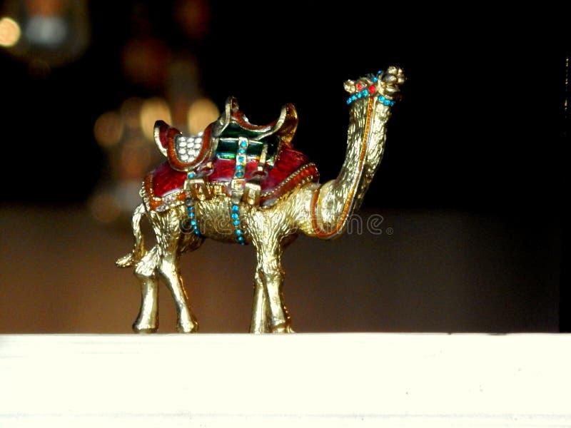 Een miniatuur van zilveren kameel stock afbeeldingen