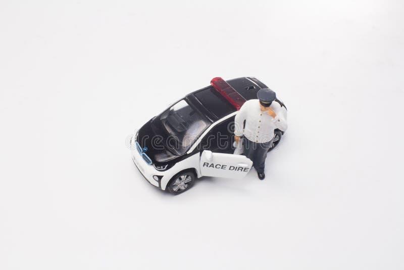 een minicijfer met de kleine auto royalty-vrije stock afbeeldingen