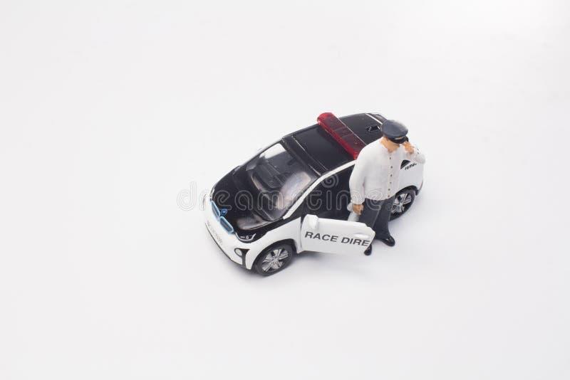 een minicijfer met de kleine auto stock foto's