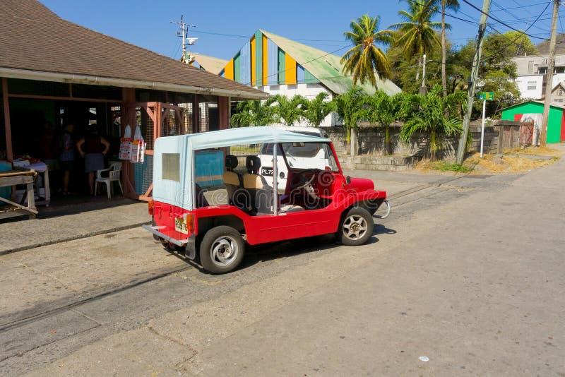 Een moke die bij een plantaardige markt in de windwaartse eilanden wordt geparkeerd stock foto's