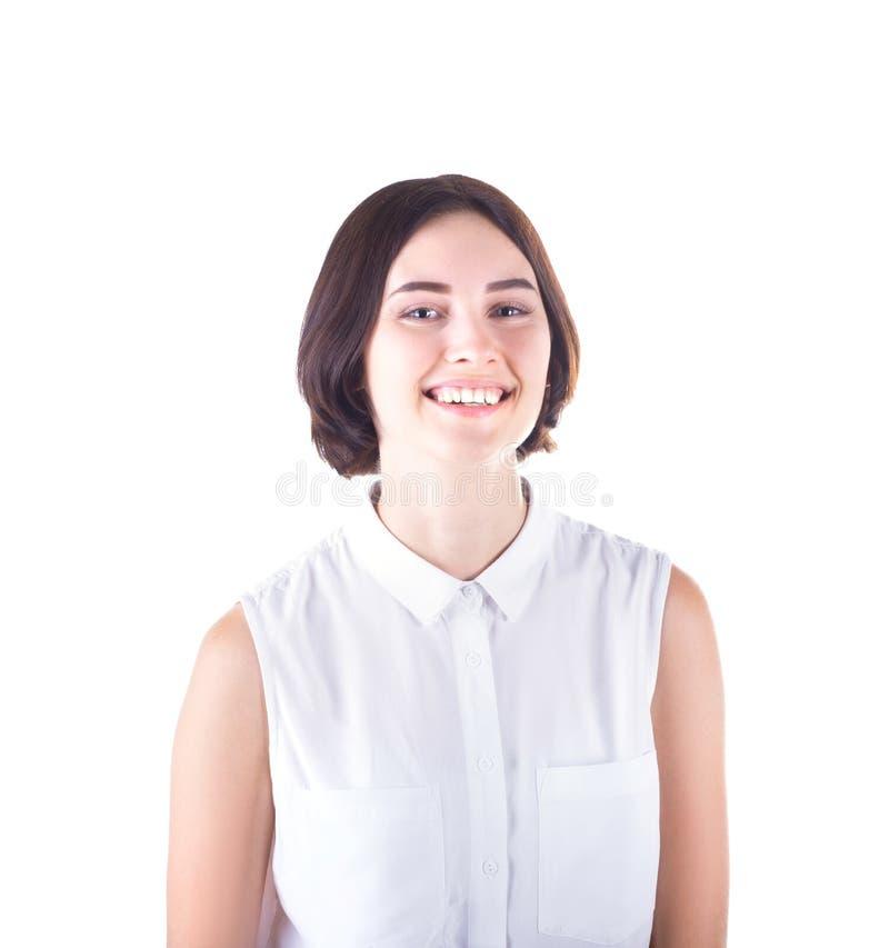 Een mooi en gelukkig studentenmeisje in een witte die blouse, op een witte achtergrond wordt geïsoleerd Een professionele bedrijf stock fotografie