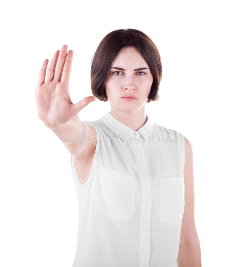 Een mooie jonge vrouw maakt een eindegebaar Een protesterend die meisje op een witte achtergrond wordt geïsoleerd Een wijfje die  stock afbeelding