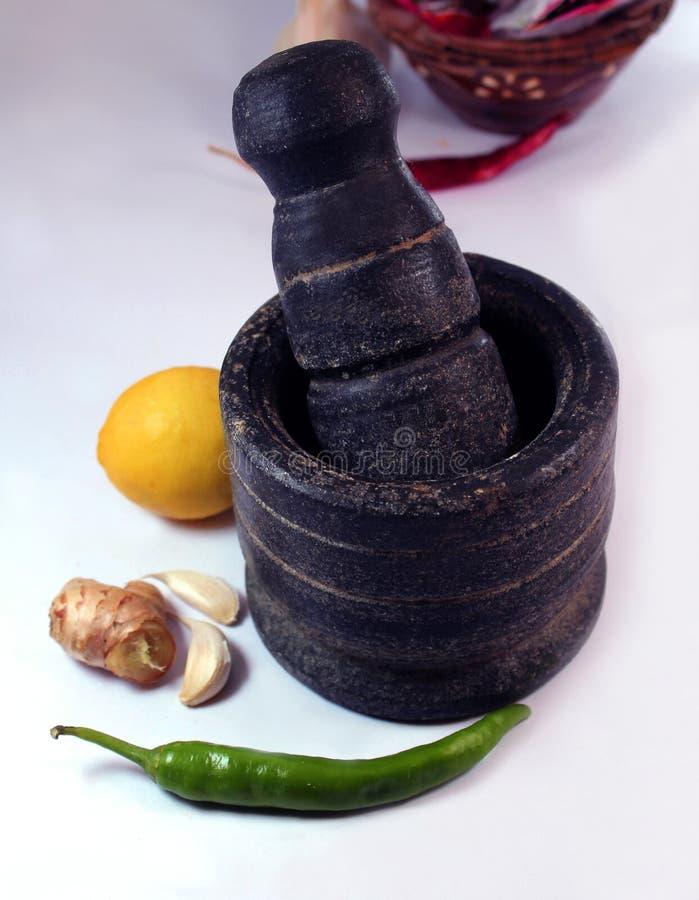 Een mortier met Indisch kokend ingrediënt royalty-vrije stock foto's
