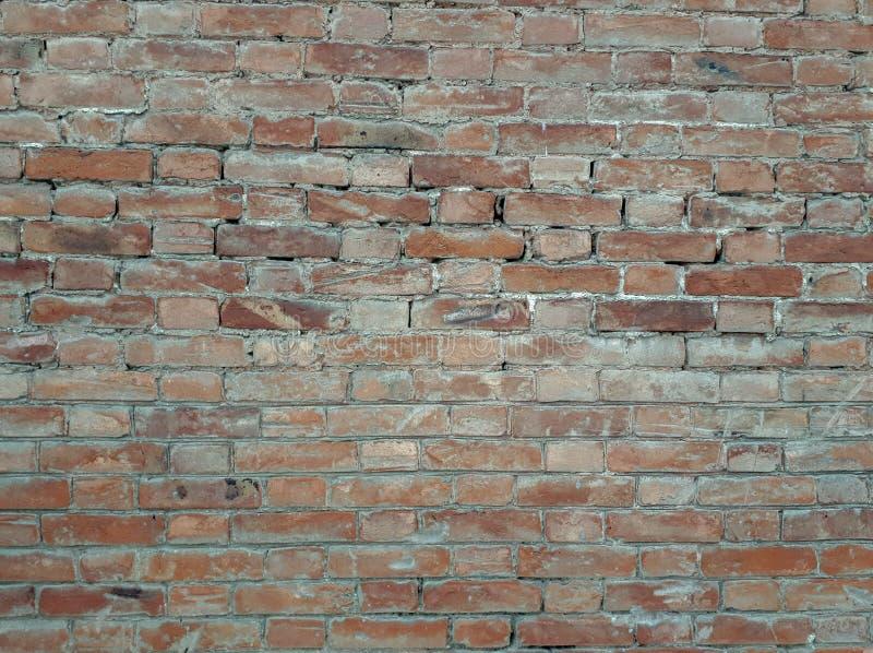 Een muur van grijze steen bricklaying stock foto's